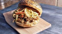 North Carolina style BBQ is vinegar-based and adds tons of tangy flavor to your pulled chicken sandwiches, straight from the slow cooker.