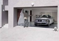 Cool stick-on facade for the garage door enables a man to live his dream... :)