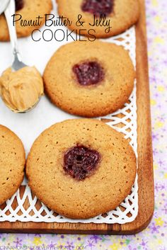 The most charming peanut butter cookies with little buttons of sticky jelly baked into the centers. #glutenfree