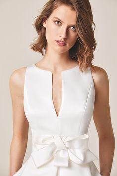 Jesus Peiro 955 Dress with teardrop shape neckline at the front and back. Half evasée skirt with great central pleat. Embellished with a draped satin bow. Simple Dresses, Elegant Dresses, Pretty Dresses, Beautiful Dresses, Designer Wedding Dresses, Bridal Dresses, Prom Dresses, Formal Dresses, Robes Glamour