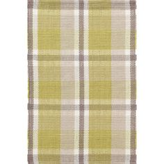 Show your plaiditude with this eco-friendly indoor/outdoor rug made of recycled materials, in an unexpected combination of moss, taupe, and grey.Made of 100% PET, a polyester fiber made from recycled plastic bottles.