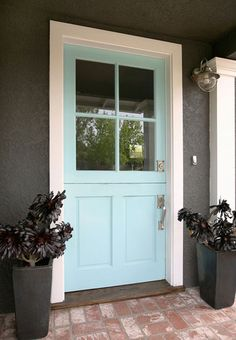 turquoise light tiffany blue front door with charcoal house paint and bright white trim