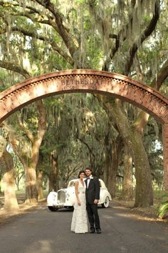 A gorgeous couple under beautiful oaks + Spanish moss at the Scarbrough House in Savannah, Georgia