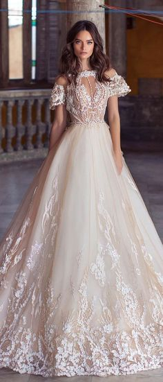 Tulle skirt adorned with three-dimensional floral appliqués and beautifully embellished top combined with cap sleeves give this gown an aristocratic touch #wedding #weddingdress #weddinggown #bridedress