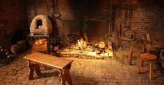 Liked on Pinterest: One of the fireplaces in Gainsborough Old Hall medieval kitchen with a fire cooking garlic broth in a cauldron