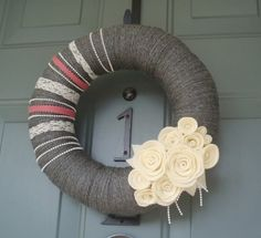 DIY winter wreath - wrap in yarn - embellish with ribbon, pearl and fabric snowflakes instead of flowers