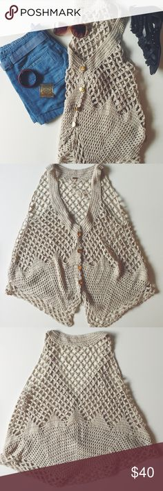 Free People Sweater Vest Free People Sweater Vest. Size: medium. 60% cotton and 40% acrylic. Sandy tan with gold buttons. Looks great with layering over tops and dresses. Great condition. Free People Sweaters Shrugs & Ponchos