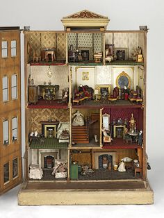 "The ""Henriques House"" Doll House.This house is known as the Henriques House because it was bequeathed to the museum by Lady Henriques. It is a model of a typical Kensington or Belgravia town house, found in long rows of elegant terraces. Vitrine Miniature, Miniature Rooms, Miniature Houses, Miniature Furniture, Doll Furniture, Dollhouse Furniture, Furniture Vintage, Antique Dollhouse, Dollhouse Dolls"