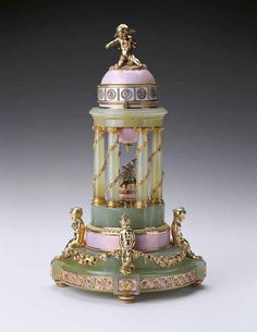 "Faberge Egg 1910 - ""Colonnade Egg"" Currently owned by Queen Elizabeth II in England. A gift at the birth of the heir Alexei."