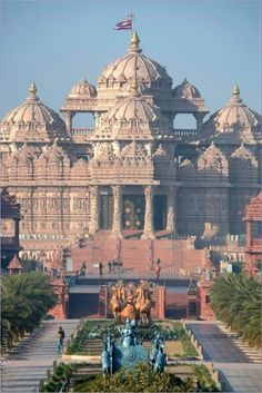 BAPS Swaminarayan Akshardham Hindu Temple, New Delhi. Built in only 5 years by 3,000 volunteers (through seva) and 7,000 Indian artisans! From ancient times the parikrama (circumambulatory path) of mandirs are pathways to express reverence and devotion to God. It is made of red stone from Rajasthan, consisting of 1,152 pillars, 145 windows and 154 samvaran shikhars; amounting to a total of 53,956 stones. The Mandir (Temple) is dedicated to Lord Swaminarayan