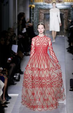 No one does red like Valentino. This spring haute couture gown recalls the swirling artistry of the Art Nouveau era in France, and its craftsmanship is unparalleled; price upon request, by special order at Valentino in the Galleria. A model presents a creation for Valentino during the Haute Couture Spring-Summer 2013 collection shows on January 23, 2013 in Paris.  Photo: PATRICK KOVARIK, Staff / AFP