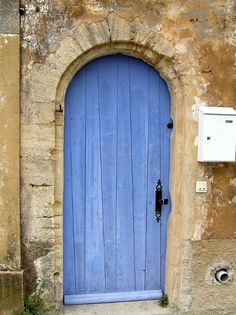 Rustic wood front door in Provence painted serenity blue