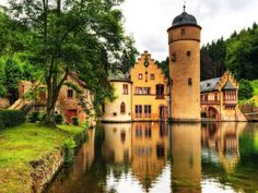 Mespelbrunn Castle is a medieval moated castle on the territory of the town of Mespelbrunn Germany, between Frankfurt and Würzburg. One of the most visited water castles in Germany, it is frequently featured in tourist books.  we were here, so beautiful