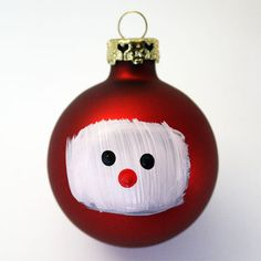 Painted Santa Ornament - the tutorial has him complete with beard and hat, but for some reason I like him just like this.