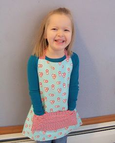 Do you know a small child who likes to help in the kitchen? My four girls certainly love to. How about making them an apron? This apron is fully reversible with a large pocket on both sides. It h...