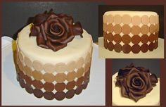 Cake is covered in marshmallow fondant with modeling chocolate dots and roses