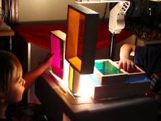 arranging toys on the overhead projector