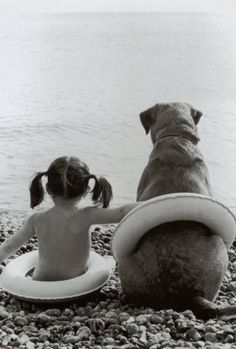 A little girl and her best friend at the beach