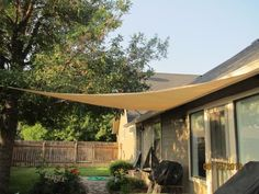 Easy Gardener, 11.8 ft. Sun Sail Triangle Garden Shade in Beige, 10908HD at The Home Depot - Mobile