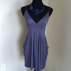 """Casual dress Pretty minidress, 29"""" long with adjustable spaghetti straps and pockets on each side. Of a grayish-brown shade which is best viewed on the 3rd picture. Another hand-me-up from my little sis! 97% cotton, 3% spandex. Size M but fits like a small. Excellent condition. 🚫Trades 🚫Lowballing, price firm. Thanks for stopping by! Timing Dresses"""