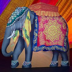 Our Asian Elephant Standee is a large gray elephant with a colorful headpiece and Asian inspired cloth. Each cardboard elephant standee measures 87 inches tall x 92 wide.