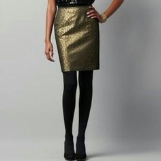 "LOFT Petite Black and Gold Metallic Pencil Skirt Ann Taylor LOFT skirt, size 4 petite, in perfect condition! Only flaw is size tag is detached on one side. Print is a black and gold metallic square print. Has pockets and zips at back. There is no stretch. Measurements are 14"" waist and 19"" length. Cover photo is from LOFT website. Please ask any and all questions before purchasing. No trades. Make a reasonable offer. Thanks! LOFT Skirts Pencil"