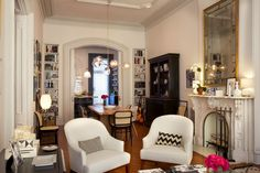 The traditional architectural details of the brownstone, such as the moldings, high ceilings, and ornate mantel, are balanced by more contemporary furnishings.