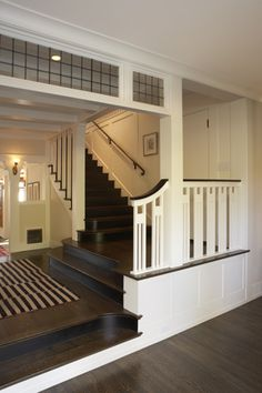 Love the mission/arts and crafts style of the staircase and also the step down into the area below
