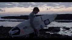 Filmmaking duo A Common Future meet the cold-water surfing community on Britain's North-East industrial coastline on NOWNESS England Top, Water Surfing, Surfs Up, Filmmaking, Light In The Dark, Surfboard, Britain, Coast, Clouds