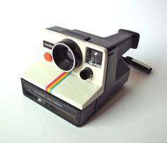 Polaroid OneStep White/Rainbow Camera Alongside the 'prosumer' range of folding SLRs, Polaroid released a large number of plastic bodied, non-folding Instant Film Camera, Vintage Polaroid, White Rainbow, Technology Gadgets, Retro Design, Inventions, Stuff To Buy, Childhood Memories, Cameras