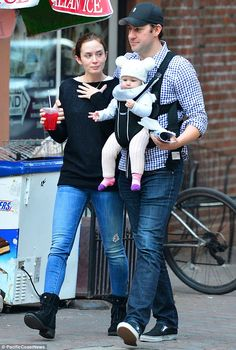 Family of three: Emily Blunt and John Krasinski took their eight-month-old daughter Hazel on an outing in New York on Monday