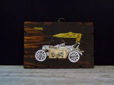 1916 Ford Car Plaque Up-Cycled Art Reclaimed Barn Wood Vintage Wall Hanging  Artisans Vision of  1916 Ford  Car Done on reclaimed wood board with scrap metal pieces App. 12 x 8 I purchased a few of these up-cycled art plaques in 1981 In Bogota Colombia and enjoyed them for many years. It is a great piece for antique car lovers garage , man cave or barn decor