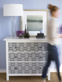 You don't have to wallpaper your whole room (nightmare!). Just do up a dresser.