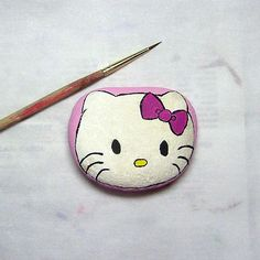 Hello Kitty painted on a rock