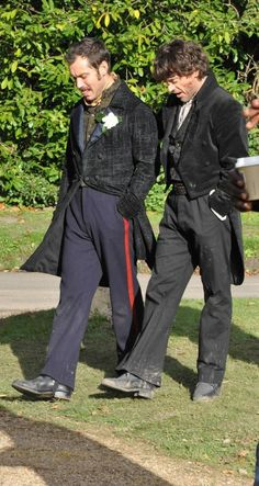 """Jude Law and Robert Downey Jr. stroll and chat during filming of the wedding scene, """"Sherlock Holmes: A Game of Shadows"""""""