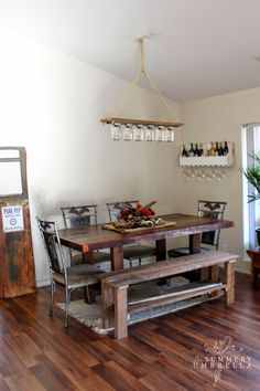 rustic reclaimed dining room with upcycled mason jar chandelier - The Summery Umbrella featured on @Remodelaholic