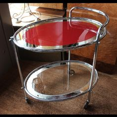 An Art Deco chromed drinks trolley with mirrored, painted shelves and original wheels. English, circa 1930 (hva)