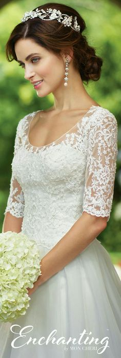 A beautiful lace wedding gown with three quarter length sleeves.