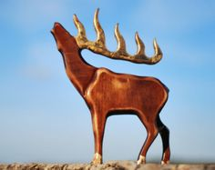 Charming wooden deer. Wooden deer made of Linden wood, which is soft, light, but strong enough. The wood is absolutely clean. Product the surface is polished well and smooth, but has no coating. Added versions dark covering. Tinted version covered with wax and linseed oil. Toys do not have sharp corners and edges. It is lightweight, soft and pleasant to the touch.  Height 10, length 8, thickness 1.5, Weight 0.75 lb