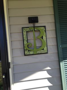 Decoupage a frame and glue a decorative initial to it!  I used a block of wood with a door knob as a hanger. Front porch redu!