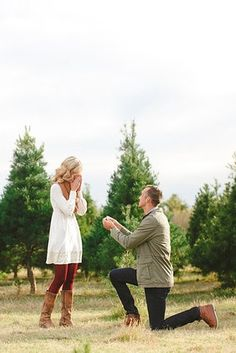 18 Christmas Proposal Ideas To Make Dream Come True ❤ christmas proposal man propose woman trees ❤ More on the blog: https://ohsoperfectproposal.com/christmas-proposal/