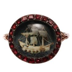Georgian ring with ivory boat under glass w/garnet surround - holy crap!