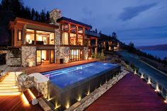 A breathtaking example of west coast contemporary design, Nautica Vista is one of British Columbia's premiere properties. Steps away from the private moorage below, this luxury home is the best combination of lake front access and hillside views. Located in Kelowna, British-Columbia, Canada, the home is situated on 2.55 acres in the lavishly rendered Sheerwater development.