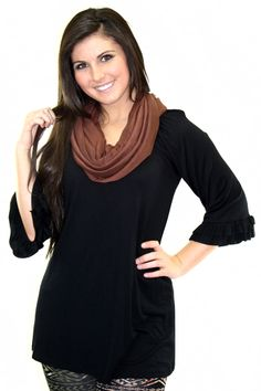 Solid black lightweight tunic with an adorable ruffled sleeve. (100% Rayon)
