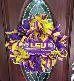 Are you looking for a wreath to show your school spirit? This LSU wreath is perfect for any Tigers fan to display! This wreath is made with yellow and purple deco mesh and has tons of purple and yellow ribbon throughout! Youll find three football embellishments and some purple and yellow deco tubing as well. To make this wreath complete there is a metal football shaped sign in the middle with the LSU tiger logo! Measurements are approximately 22 diameter x 4 deep. This can be hung indoors…