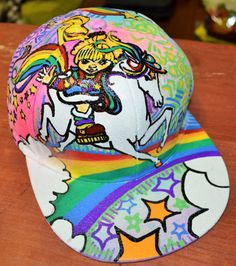 RAINBOW BRITE Snapback hand drawn and painted Hat by kmaklothing Painted Hats, Rainbow Brite, Snapback, The Darkest, How To Draw Hands, Glow, Care Bears, Trending Outfits, Unique Jewelry