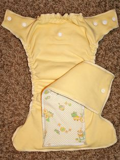 DIY cloth diaper made from baby blanket I highly doubt I'll do this, but it's an interesting thought.