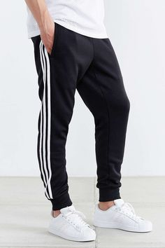 Those iconic three stripes and trefoil logo have topped adidas sneakers, tees, hoodies + so much more for over 60 years. Jogger Adidas, Pants Adidas, Adidas Sweatpants, Sweatpants Outfit, Adidas Men, Adidas Track Pants Mens, Adidas Joggers Outfit, Adidas Sportswear, Men's Pants