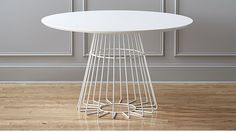 compass dining table CB2 - airy and geometric table. This will be great in the kitchen!
