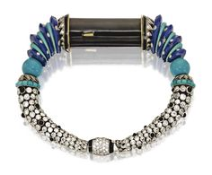 EGYPTIAN-STYLE LAPIS LAZULI, TURQUOISE, DIAMOND, BLACK ONYX AND ENAMEL BRACELET, CARTIER, PARIS, 1929, MADE BY SPECIAL ORDER FOR MRS. COLE PORTER..